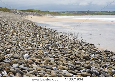 pebbled ballybunion beach beside the links golf course in county kerry ireland