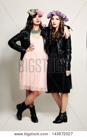 Fashion Girl Friends Standing on Background. Two Woman Fashion Model