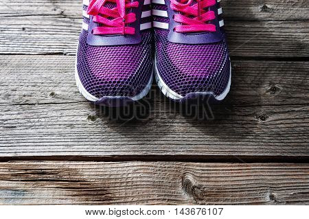 Pair of sport shoes on grey wooden background, Sport accessories and fashion, Healthy lifestyle.
