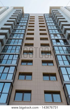 multistorey highrise apartment building on the sky background