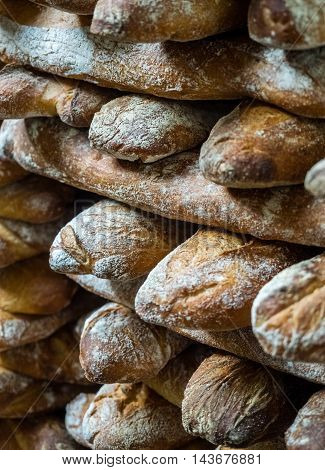 Close up of freshly baked baguettes on market stall in Borough market in London