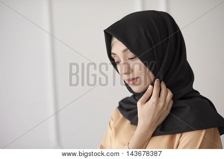 portrait of a beautiful Muslim woman in traditional Islamic clothing and cover their heads Ufa