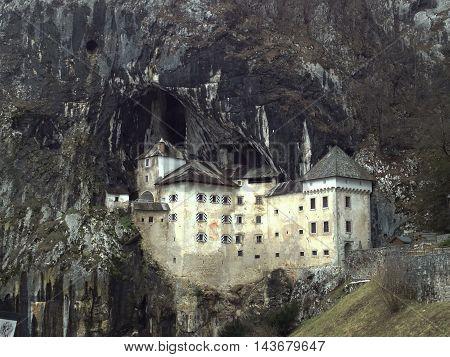 View of Predjama Castle built inside the rock