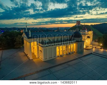 Aerial top night view of Old Town in Vilnius, Lithuania: the cathedral and Upper Castle in sunrise