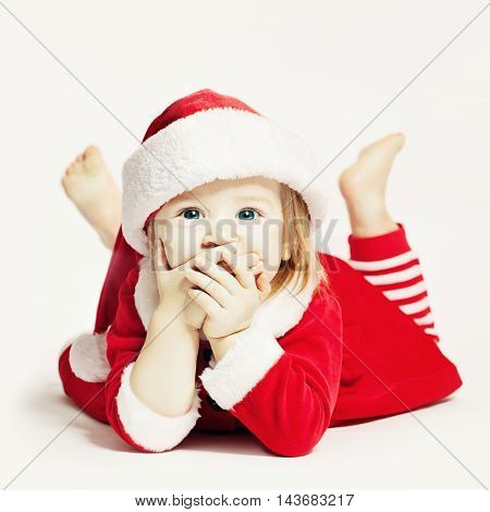Happy Baby in Santa Hat. Infant Child Laughing