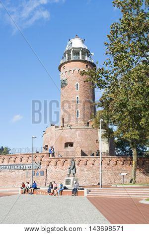 KOLOBRZEG - AUGUST 15: The area harbor and the lighthouse full of tourists who are watching the city's attractions on 15 August 2016 in Kolobrzeg, Poland. Visible lighthouse was built in 1945.