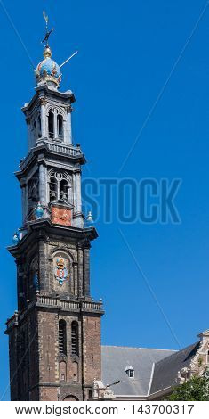 Amsterdam the Netherlands - August 16 2016: The tower of the Westerkerk is isolated against blue sky.