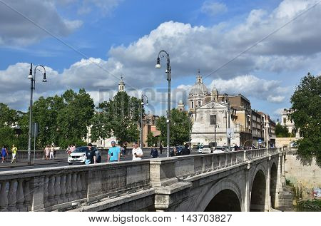 ROME, ITALY - MAY 30: People and cars cross Ponte Cavour bridge in the city center MAY 30, 2016 in Rome, Italy