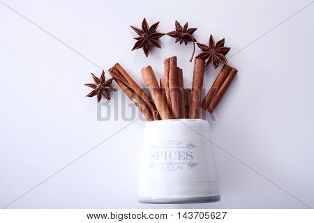 cinnamon sticks anise star and spices jar on the white background