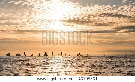 Silhouettes Of Beautiful Couple With Sup Serf