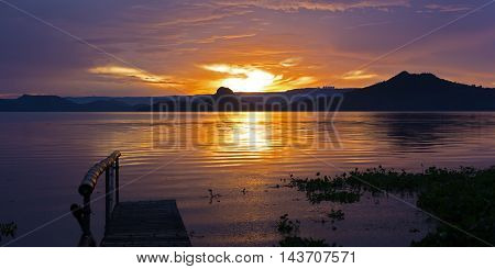 Golden sunset on the Lake Taal Philippines. Taal Island is in close proximity to the industrial area of Manilla.