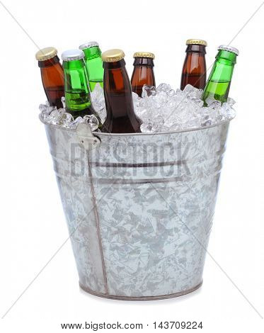 Assorted beer bottles in a bucket of ice isolated on a white background. Vertical format with reflection.