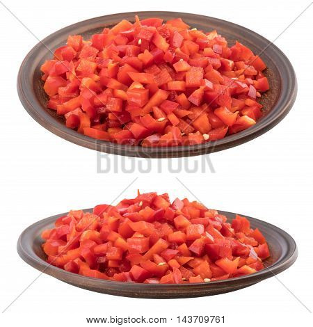Sliced red pepper in a brown ceramic plate. Isolated on white background. Selective focus.