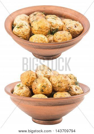 Baked potatoes with spices in an old clay bowl. Selective focus.