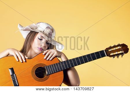 Woman Lying On A Acoustic Guitar.