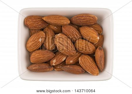 Almonds in a bowl isolated on white background.