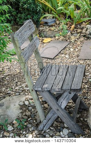 Old wooden chair sitting in the garden