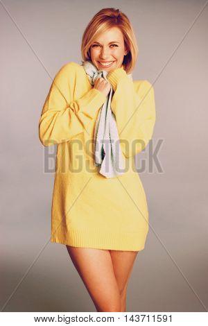 Smiling woman wearing yellow sweater