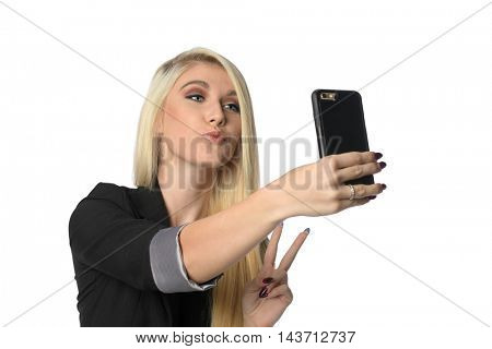 Young businesswoman taking selfie with cellphone isolated over white background