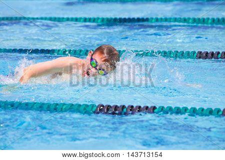 Boy in a freestyle swim race