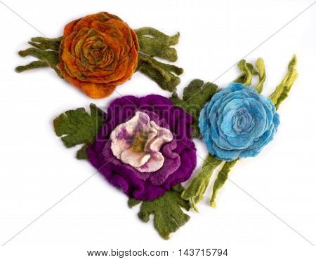 Three brooches from felted wool on a white background poster