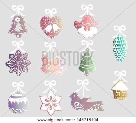 set of colorful decorations with white ribbons for the Christmas tree - a bell, heart, angel, star, bird, tree, pine cone, ball, house