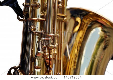Fragment Of  Saxophone On White Background.