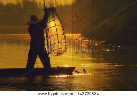 Fishermen fishing in the morning Mekong River Thailand.