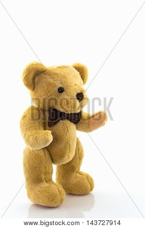 Classic teddy bear isolated on white background. Brown teddy standing on its feet.