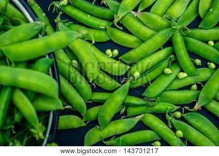 Fresh green peas on a wooden table