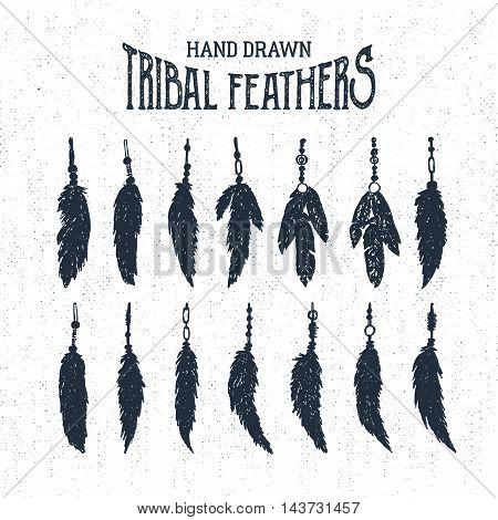 Hand drawn tribal style feathers set. Vector illustration.
