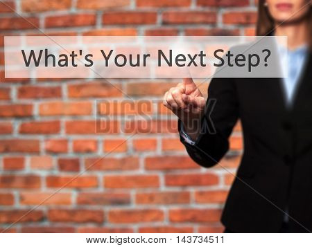 What's Your Next Step? - Businesswoman Hand Pressing Button On Touch Screen Interface.