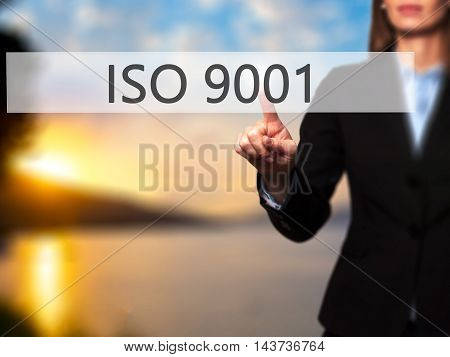 Iso 9001 - Businesswoman Hand Pressing Button On Touch Screen Interface.