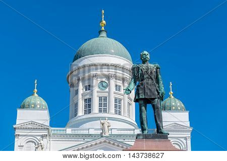 Statue of Russian Emperor Alexander II and Lutheran Cathedral on the Senate Square. Helsinki Finland Scandinavia