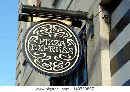 LONDON ENGLAND - 8 JULY 2016: Pizza Express sign over restaurant founded in 1965 by Peter Boizot.