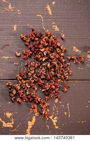 Chinese Sichuan pepper on old wooden background