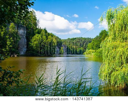 Beautiful lake and sandstone towers in Bohemian Paradise, or Cesky Raj, on sunny summer day, Czech Republic