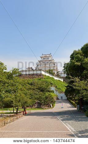 HIMEJI JAPAN - JULY 21 2016: Main keep (tenshukaku) of Himeji castle (White Egret Castle circa 1609) after repairing works ended 2015. National Treasure of Japan and UNESCO World Heritage Site