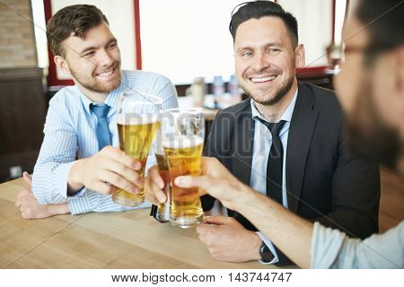 Businessmen Celebrating with Beer