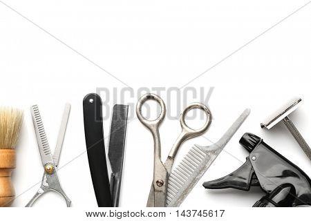 Vintage tools of barber shop on white background