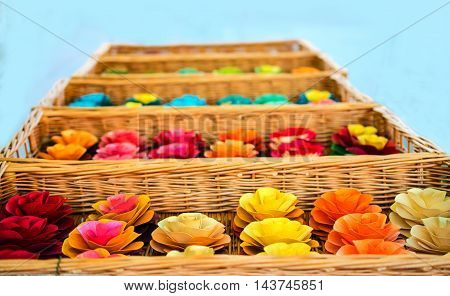 Colorful flowers in boxes. On a blue background.