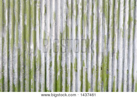 An old corrugated iron fence with green paint. poster