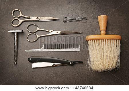 Vintage tools of barber shop on grey background