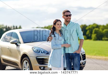 transport, road trip, travel, family and people concept - happy man and woman hugging at car