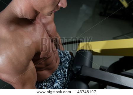 Trapezius Exercise On Machine In Gym