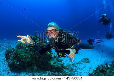 Scuba Dive. Woman scuba diver.