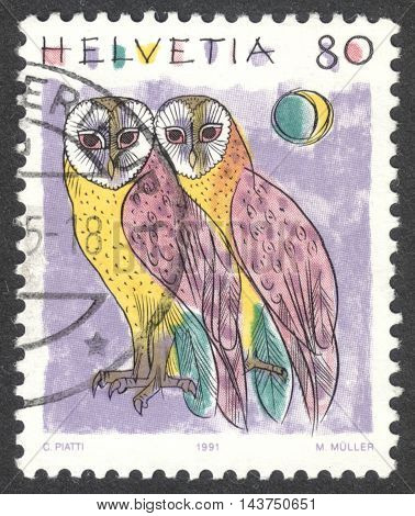 MOSCOW RUSSIA - CIRCA JULY 2016: a post stamp printed in SWITZERLAND shows a barn owl (Tyto alba) the series