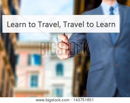Learn To Travel Travel To Learn - Business Man Showing Sign