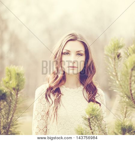 Fashion Portrait of Beautiful Woman with dark hair Outdoors