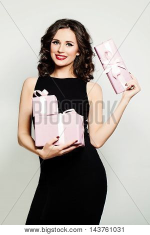 Smiling Woman Fashion Model Showing Holding Gift Box